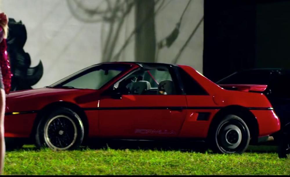 Mark Wahlberg with Pontiac 1988 Fiero Base 2dr STD Coupe in Pain & Gain