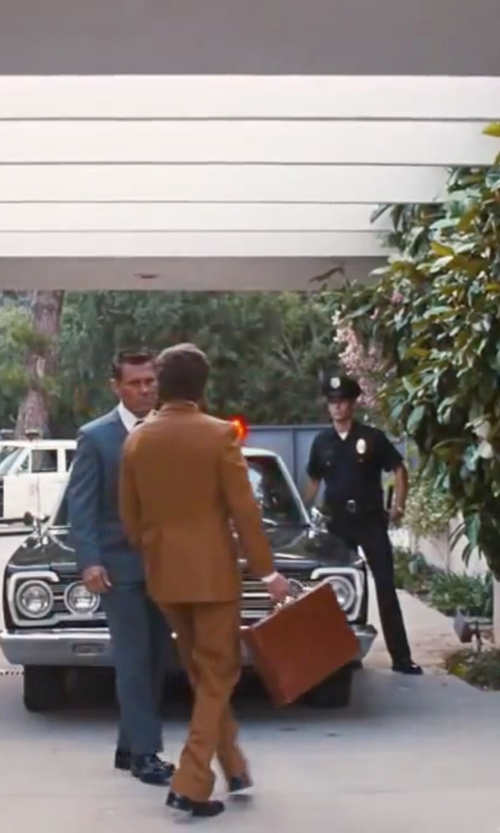 Joaquin Phoenix with Mcklein Harper Expandable Briefcase in Inherent Vice