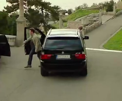 Unknown Actor with BMW X5 M SUV in The November Man