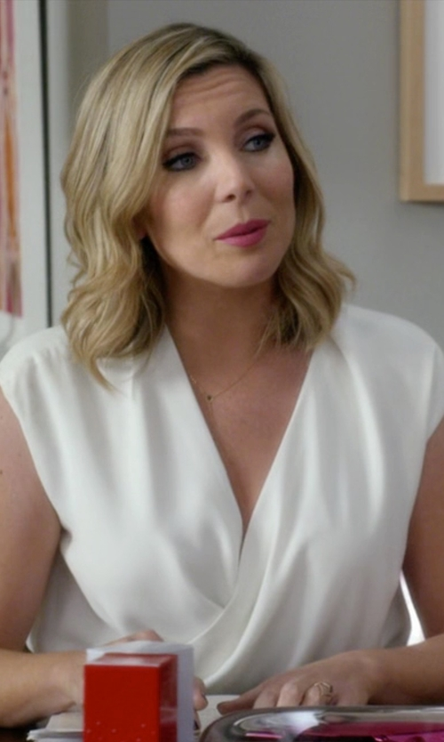 June Diane Raphael with Donna Karan Cap-Sleeve Peplum Jacket-Style Wrap Top in Grace and Frankie