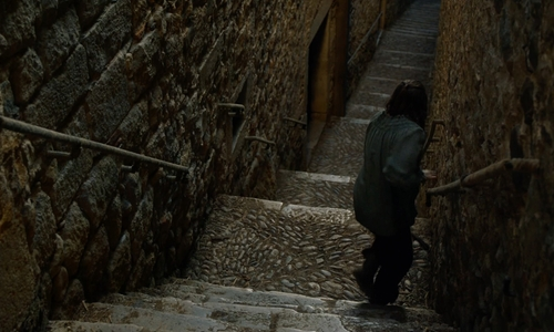 Maisie Williams with Carrer de Sant Llorenç (Depicted as an alley in Braavos) Girona, Spain in Game of Thrones