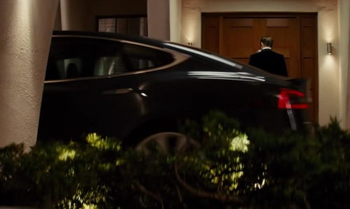 Colin Firth with Tesla Model S Sedan in Kingsman: The Secret Service