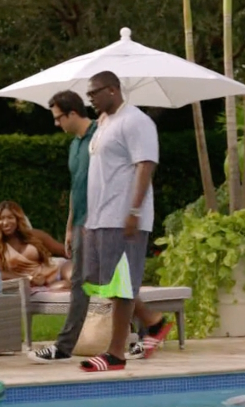 Donovan W. Carter with Adidas Originals 'Adilette' Sliders in Ballers