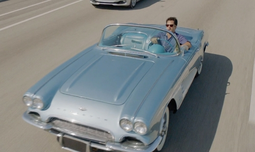 Troy Garity with Chevrolet 1961 Corvette Convertible in Ballers