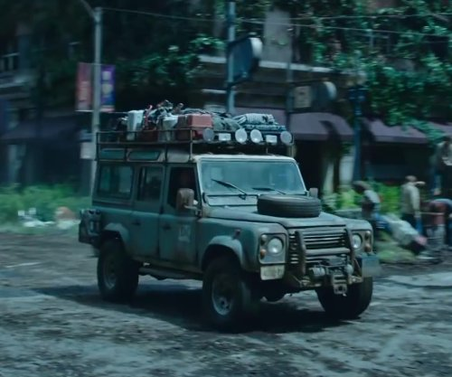 Unknown Actor with LAND ROVER Defender 110 Station Wagon in Dawn of the Planet of the Apes