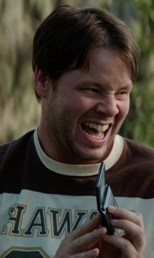 Ike Barinholtz with Pantech Impact OLED Touchscreen Dialing Pad in Neighbors