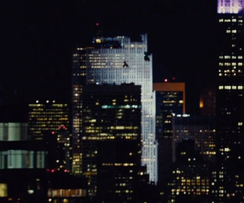 Unknown Actor with GE Building New York City, New York in Run All Night