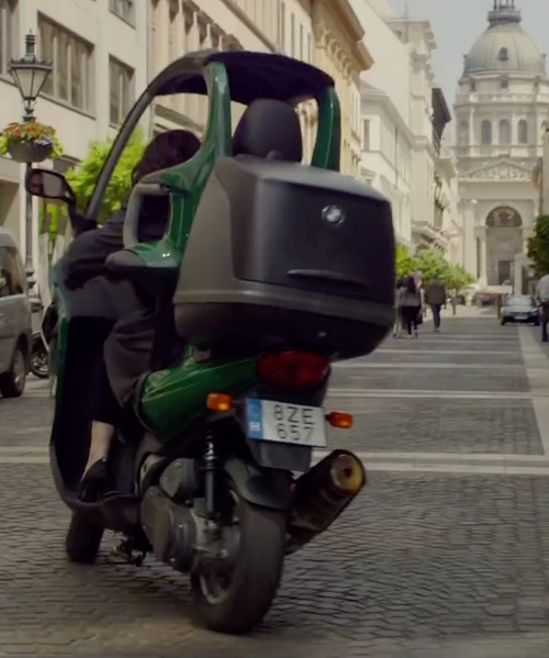 Melissa McCarthy with BMW 2001 C1 Roof Scooter in Spy