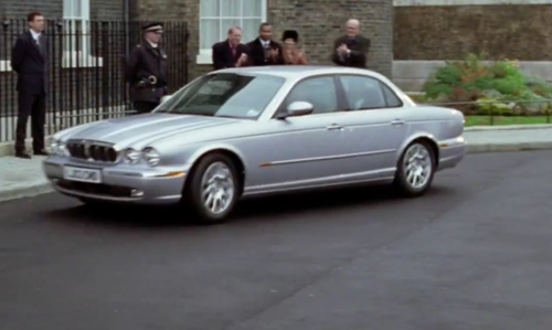 Hugh Grant with Jaguar XJ6 Sedan in Love Actually