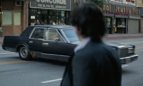 Michael Kenneth Williams with Lincoln Continental in The Gambler