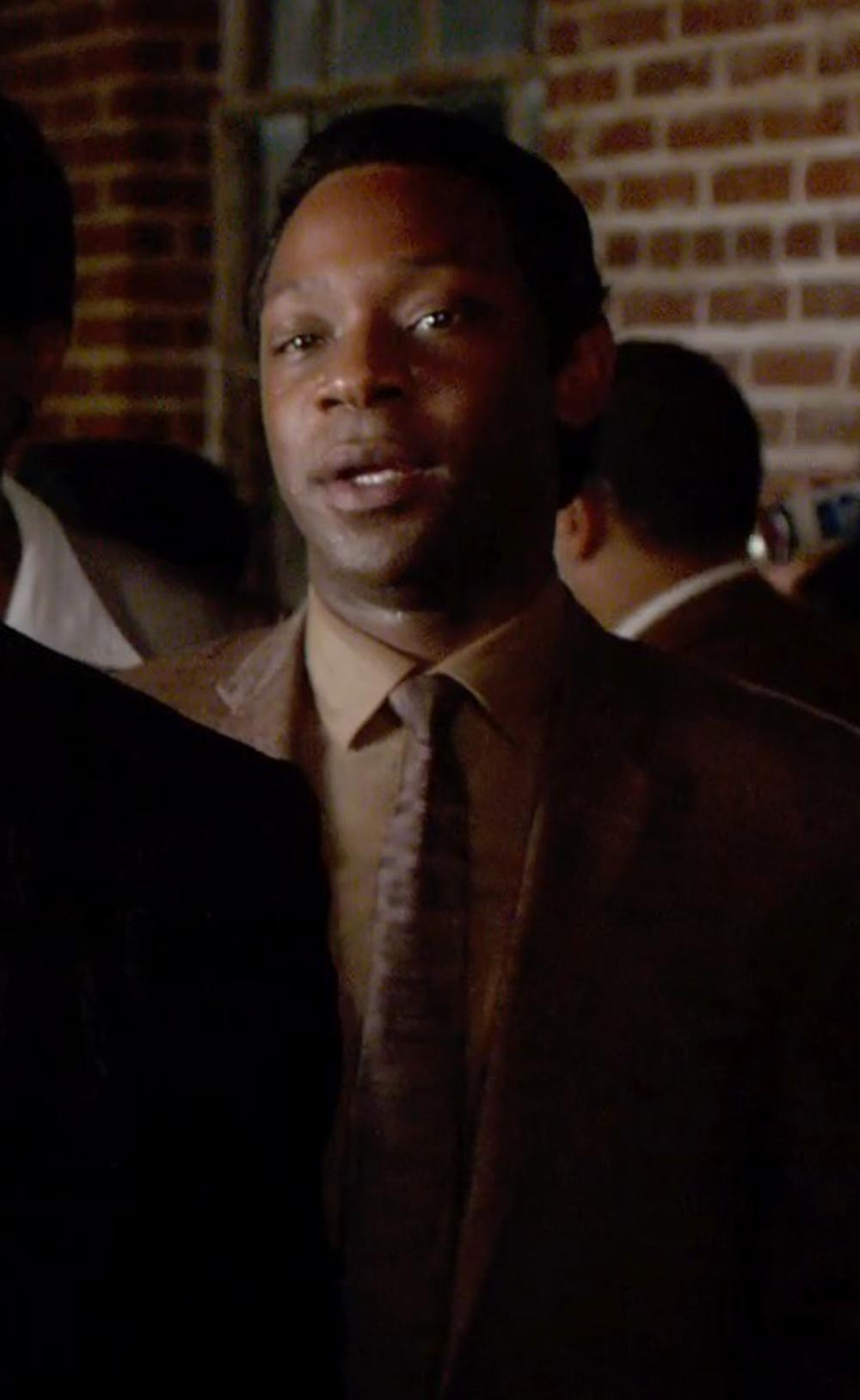 Nelsan Ellis with JoS. A. Bank Signature Large Medallion Tie in Get On Up