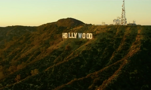 Dax Shepard with Hollywood Sign Los Angeles, California in CHIPs