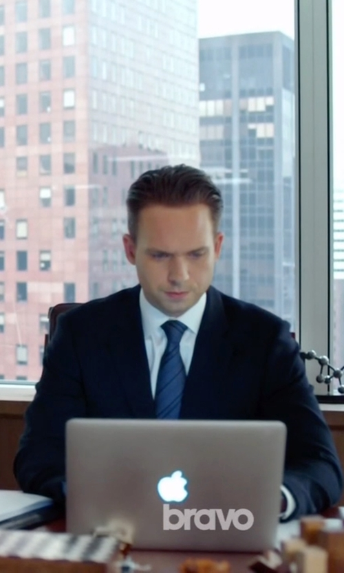 Patrick J. Adams with Apple MacBook Pro Laptop in Suits