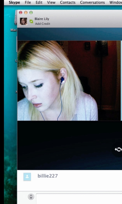 Renee Olstead with Skullcandy Earbud Headphones in Unfriended
