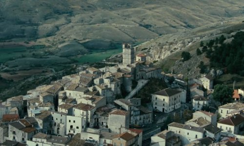 Unknown Actor with Castel del Monte, L'Aquila Abruzzo, Italy in The American