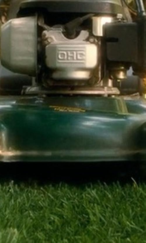 Unknown Actor with Lawn-Boy High Wheel Push Gas Walk Behind Lawn Mower in Crazy, Stupid, Love.