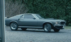 Keanu Reeves with Ford 1969 Mustang Mach1 Coupe in John Wick