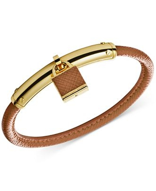 Gold-Tone Leather Padlock Bangle Bracelet by Michael Kors in Jem and the Holograms