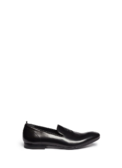 Skull Embossed Leather Slip-On Shoes by Alexander McQueen in Self/Less