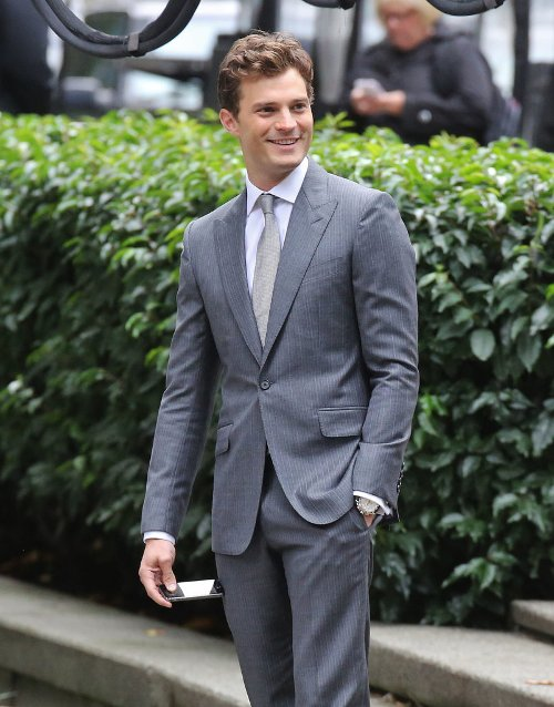 Custom Made Gray Pinstripe Suit by Mark Bridges (Costume Designer) in Fifty Shades of Grey