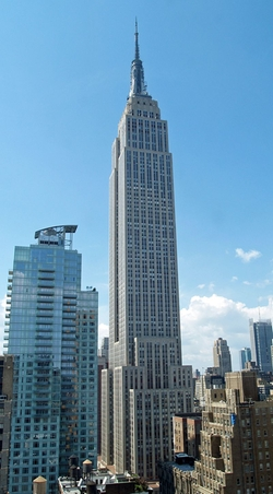 New York City, New York by Empire State Building in Suits