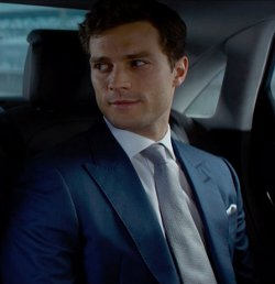 Custom Made Navy Peaked Lapel Suit by Mark Bridges (Costume Designer) in Fifty Shades of Grey