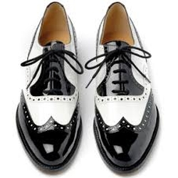 Black/White with Navy/Gold Trim Saddle Shoes by Born in Pitch Perfect 2