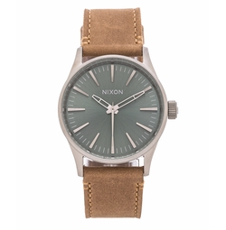 The Sentry 38 Leather Watch by Nixon in A Bad Moms Christmas