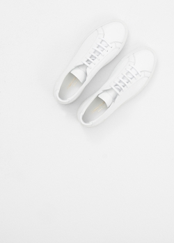 White Original Achilles Low Sneaker by Common Projects in Master of None