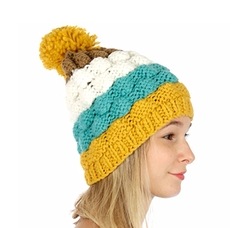 Hand Knit Pom Pom Beanie by Crown in Unbreakable Kimmy Schmidt