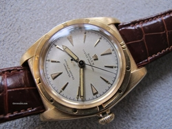 Vintage 1946 Bubbleback Oyster Perpetual Chronometer Gold Watch by Rolex in Crazy, Stupid, Love.