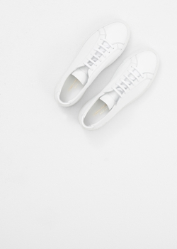 Original Achilles Low Sneaker by Common Projects in Master of None