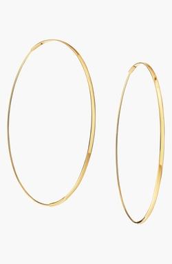 Large Flat Magic Hoop Earrings by Lana Jewelry in Focus