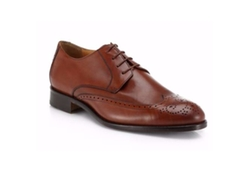 Leather Lace-Up Wing-Tip Shoes by Saks Fifth Avenue Collection in Modern Family