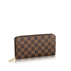 Damier Ebene Canvas Zippy Wallet by Louis Vuitton in The Longest Ride