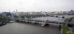 London, United Kingdom by Hungerford Bridge and Golden Jubilee Bridges in Survivor